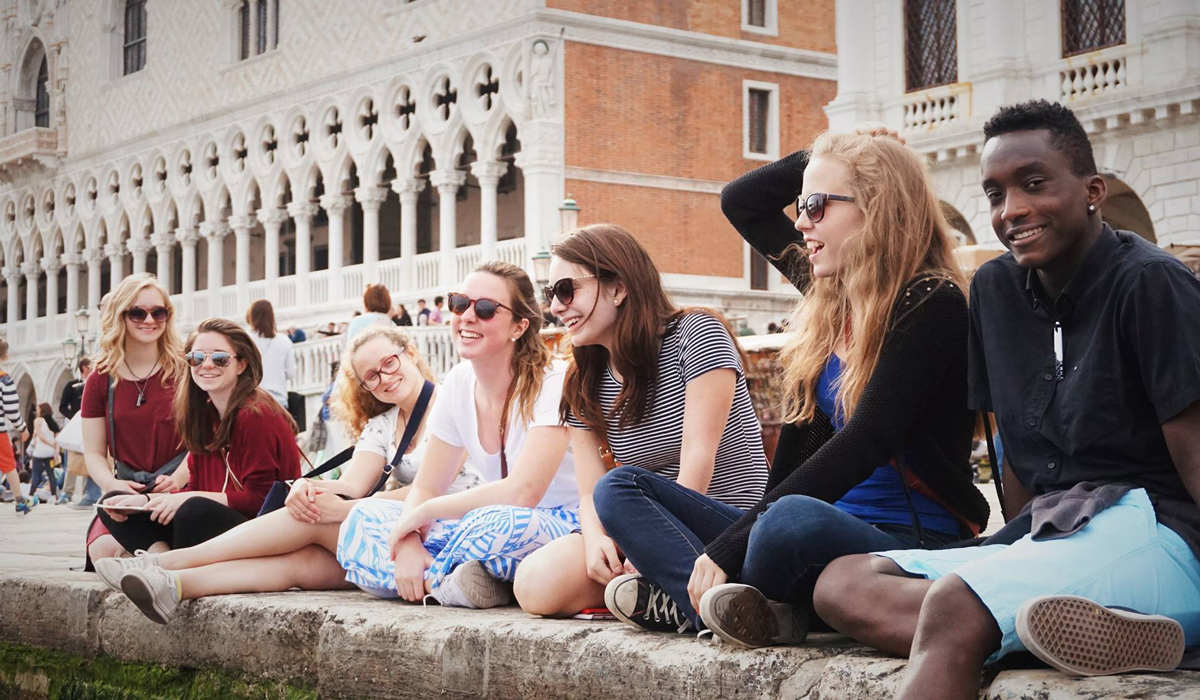 Students in Venice near the water canal